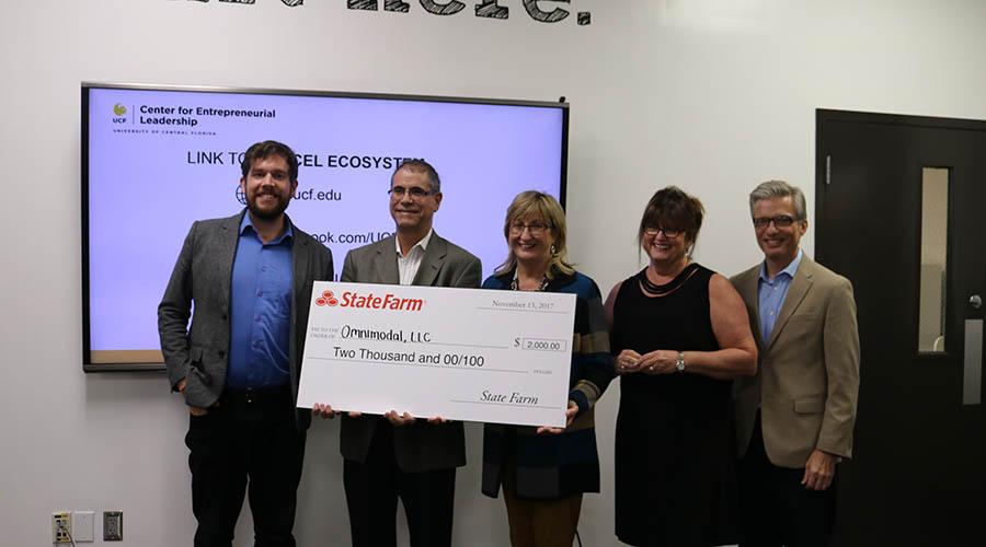 Social Venture Winner Receiving State Farm Check